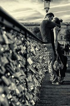 "Lovers on a ""love-lock"" bridge"