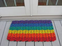 Brightly colored handwoven rainbow doormat from lobster trap rope.. $50.00, via Etsy.