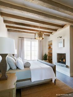 Wood beams in small room with low ceiling Nice bed frame.