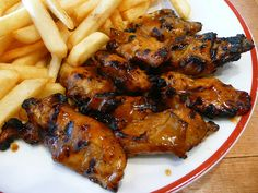 Nando's chicken ribs and chips by The Food Pornographer, via Flickr - my new fav take away - yummmmm