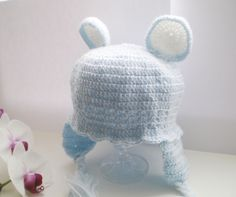 """Cute   cotton """"bear"""" baby hat in blue.  Colour: You can choose:   lilac, white, cream or rose.  Designed and knitted by myself.  100% Cotton.    Wa..."""