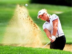 Brooke Henderson hits out of a bunker on the fifth hole during the third round of the LPGA Cambia Portland Classic in Portland, Ore., on Saturday, Aug. 15, 2015. (via ottawacitizen.com) STEVE DYKES / THE ASSOCIATED PRESS
