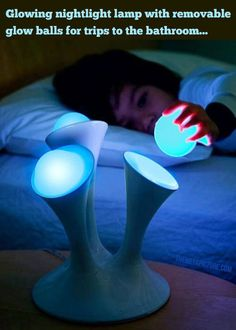 This night lamp features removable glow balls that can be easily picked up and taken with you.