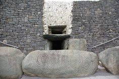 Newgrange is a prehistoric monument in County Meath, Ireland, about one kilometre north of the River Boyne. It was built about 3200 BC, during the Neolithic period, which makes it older than Stonehenge and the Egyptian pyramids. from Wikipedia #stone