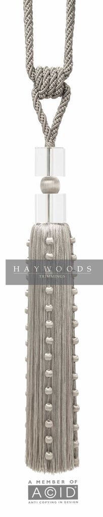 An elegant tassel featuring glass cubes and year covered balls