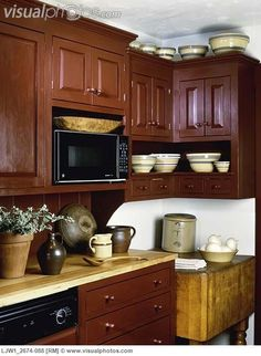 KITCHEN: Contemporary Period Country Antique Pottery And Wooden Ware On Maple Counter Top Painted Cranberry Furniture Style Cabinets Corner Area With Antique Butchers Block Yellowware Bowls Primitive Kitchen, Rustic Kitchen, Kitchen Dining, Farmhouse Kitchens, Country Kitchens, Primitive Country, Primitive Decor, Prim Decor, Dining Rooms