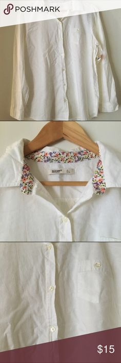 White Collared Button Down A white button down that has a collar and buttons all the way down and a pocket on the chest. It's long sleeves and has a button the sleeves as well. Old Navy Tops Button Down Shirts