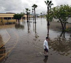 Billions to be lost in south Florida from climate change   An identified man makes his way across the plaza in knee-high storm water. Hunter Plaza in Homestead, Florida is flooded due to the rains from Hurricane Katrina. Many storefronts were badly damaged by the intrusion of storm water.