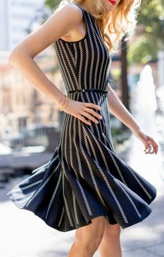 One of my absolute favorites for spring is this uber-flatter #StJohnKnits black knit sleeveless fit and flare dress with gold cord stripes. sjk.com