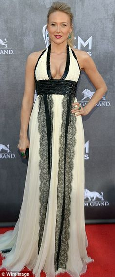 Elegant evening wear: Jewel, left, wore a cream and black chiffon gown