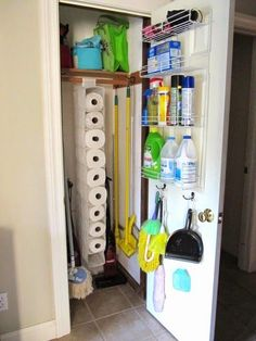 broom closet organization love the paper towels in the shoe thing