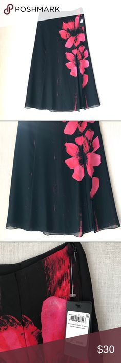 """Guess Black Floral Maxi Skirt, High Slit, Large Gorgeous black maxi skirt by Guess in size large   Skirt features a bright pink flower print and a sexy 24.5"""" front side slit.  New with tags (msrp 99.99)  Measurements when laying flat Waist - 31"""" Length - 40""""  Don't forget to heart your favorites to bookmark for later. Thanks for stopping by my closet!   Guess Black Floral Maxi Skirt with High Slit, Size Large Guess Skirts Maxi"""