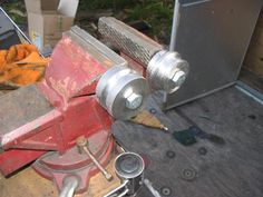"""Beadroller by the poi -- Homemade beadroller fashioned by bolting 2""""x1"""" steel beading discs to a bench vise. http://www.homemadetools.net/homemade-beadroller"""
