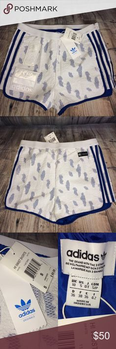 Adidas Three Stripes Jacquard 70's Inspired Shorts New with tag ladies Adidas shorts. White with blue stripes on the side and jacquard fabric. Patches on front inspired by the 1970's.  Elastic waist with zipper on the side. Two front pockets. Size Small. Retail $65.00. Please see pics. Smoke-free home, but cat friendly. 🐱 No trades, try-ons, or off Posh sales. Feel free to ask questions. Thank you. 💖💖 adidas Shorts