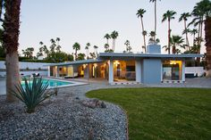 Palm springs exterior midcentury home renovations with pool covered patio
