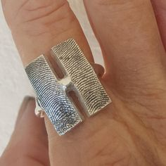Fingerprint Ring Jewelry Thumbprint Band Personalized Sterling Silver. We are introducing our newest jewelry that takes 2 fingerprints and puts them on a beautiful ring, casting it as one piece and creating a beautiful piece of sterling silver jewelry. This ring are 2 slivers cut
