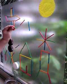 A Little Learning For Two sticky paper and toothpicks window activity