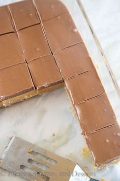Reese's Fudge - a layer of creamy peanut butter fudge topped with melted chocolate and peanut butter. And easy no bake recipe that is down right addicting!