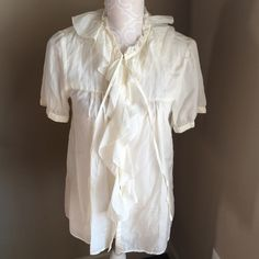 J Crew Ruffle Blouse Brand NWT. 57%cotton/ 43% silk. Gorgeous cream color with buttons down the front. Tie at neck. J. Crew Tops Button Down Shirts