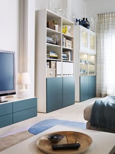 Keep your space organized with our turquoise BESTÅ and INREDA shelving units.