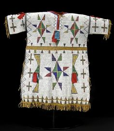 A Sioux fully-beaded buckskin dress (est.  $40/60,000) will be offered by Bonhams & Butterfields in San Francisco on 7 June 2010 during the summer Native American Art auction.  Imaginatively decorated with a profusion of geometric configurations - mostly triangle and diamond forms - the dress is 29-inches in length...  Photo Credit: Courtesy Bonhams & Butterfields