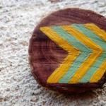 Spotted: Painted Brooches Made from Fallen Tree Limbs