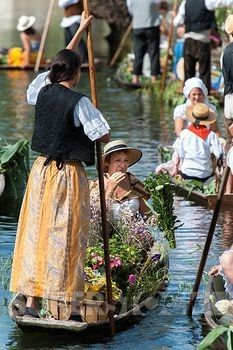 L'Isle-sur-la-Sorgue, Provence traditional floating market, held on the first Sunday in August.  Vendors wear traditional dress and sell from their flat bottomed boats.