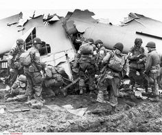 American paratroopers of the 101st Airborne Division assisting survivors of two amphibious gliders that crashed behind the German lines near the city of Arnhem, 17 September 1944