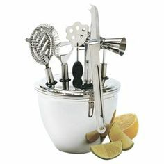 """8-piece stainless steel bar tool set with ice bucket.    Product:  Double jigger Bar knife Stirring stick Bottle opener  Cocktail strainer  Ice tongs Tool insert   Ice bucket Construction Material: Stainless steelColor: SilverDimensions: 6.5"""" H x 6.5"""" Diameter (ice bucket)Cleaning and Care: Hand wash recommended"""