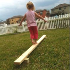Quick balance beam for kids. One 2x4 and two pieces of 4x4 put together with nails. Sand to get rid of roughness. About $5 total. Great tool to increase your child's gross motor skills and balance!