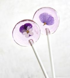 Make your own candy lollipops featuring edible flowers. This spring craft makes a wonderful party favor or gift for friends.