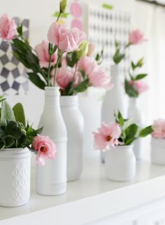 White bottles, pink flowers... I can see this perfectly on our kitchen window sill :)