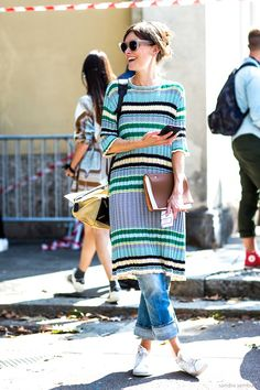 Here's a cool way to wear a striped dress for spring—with jeans and white sneakers.