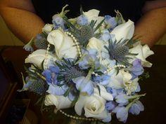 Blue delphinium, white roses