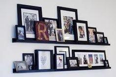 black picture ledges with black frames