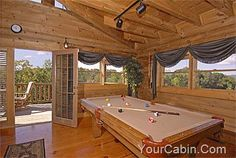 """A Slice O' Paradise is a 2 story, 1 BR, 1 BA cabin, perfect for relaxation or recreation near Pigeon Forge. As you enter this cabin into the living area there are cathedral ceilings, a full size pool table, sleeper sofa and chair set in front of a cozy gas log fireplace and 46"""" HD TV which offers cable with HBO/Showtime and a DVD Player. The fully equipped kitchen provides everything you need and there is a laundry closet with a stack washer/dryer for those extended stays. #honeymoon #cabins"""