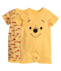 Yellow/Winnie the Pooh. Two pajama bodysuits in soft cotton jersey with a…