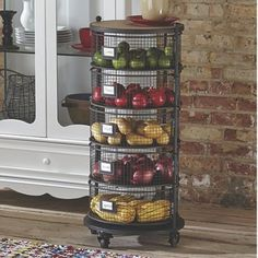Round Organizer from Country Door. Keep your kitchen organized with this attractive space-saving, 5-tiered shelf on casters (2 locking). Round metal bins swing out when needed, or lock into place, and have a slot for labeling.