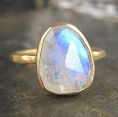 d e t a i l s  A stunning 9 x 11mm rose cut rainbow moonstone has been wrapped in the sunny warmth of recycled 14k gold and mounted upon a