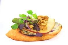 Bruschetta: blue cheese, pear, walnut, lavender honey, micro salad.  A creation by Celsius Cuisine & Catering