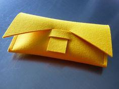 ArtAK YELLOW Felt Wallet / Clutch. Money Bills. 100% Wool Felt. Handmade. Ideal for travel and fun. Clean & Smart design. Yellow Clutch. $25.00, via Etsy.