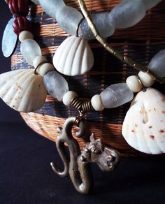 """Designer tribal necklace with African and Nagaland beads. """"SEA DRAGON""""  Ethnic bone, coin & bronze beads. Tribal. Mauritanian Saharan shell by Timbuktugallery on Etsy"""
