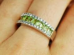 Google Image Result for http://www.cmstatic1.com/31400/c/engagement-ring-15-carat-peridot-ring-with-diamond--UDU2Ny0zMTQwMC4xMzYyNDY%3D.jpg