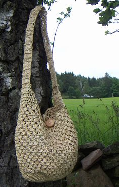 Shoulder bag crochet of palmleaves. Wooden button. Fair Trade sustainable fashion.