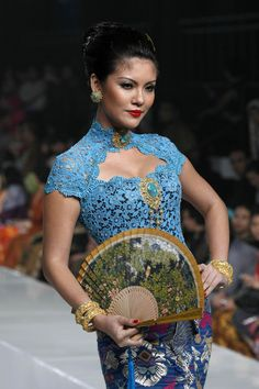"""A model showcases designs on the runway by Priyo Octaviano as part of the Opening Night """"Styling Modernity: A Tribute To Kebaya"""" show opening Jakarta Fashion Week 2010 at the Fashion Tent, Pacific Place on November 6, 2010 in Jakarta, Indonesia."""
