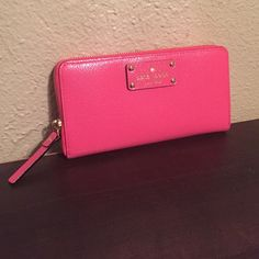 NWT Kate spade pink wallet NWT Kate spade pink wallet had 12 card slots 6 slips for cash and a zipper for change. Wallet carries everything! No trades please use offer button. kate spade Bags Wallets