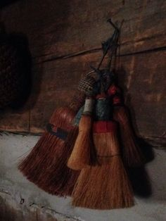 Collection of old whisk brooms.