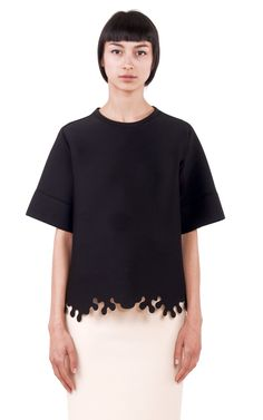 This black neoprene Ioana Ciolacu Bounty Sweater top features a round neck, raglan sleeves, and a laser cut hem. Tunic Tops, Chic, Outfit, Sleeves, Model, Sweaters, Shopping, Clothes, Dark Matter