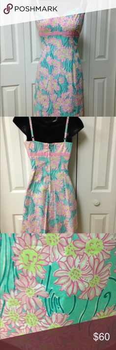 Lily Pulitzer sundress Pretty turquoise with pink flowers. Adjustable straps. Empire waist trim and grosgrain ribbon .sweetheart neckline. Lilly Pulitzer Dresses