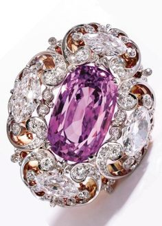 Gold, Platinum, Purplish Pink Sapphire and Diamond Brooch, Circa 1900. Centring an elongated cushion-shaped purplish pink sapphire weighing 24.54 carats, within an openwork frame set with 2 larger marquise-shaped diamonds and 2 smaller marquise-shaped diamonds, accented by old European- and single-cut diamonds, inscribed N. McKee Graham 1904. #antique #BelleEpoque #Edwardian #brooch